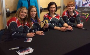 Team Jennifer Jones signing autographs at the Goldline booth following their extra end win this afternoon at the Players' Ch'ship